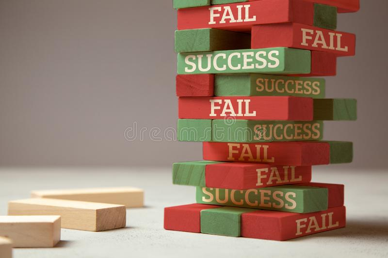 Success and fail. Wooden tower of blocks. Failure is like new step for success. Failure gives experience and makes you successful royalty free stock photography