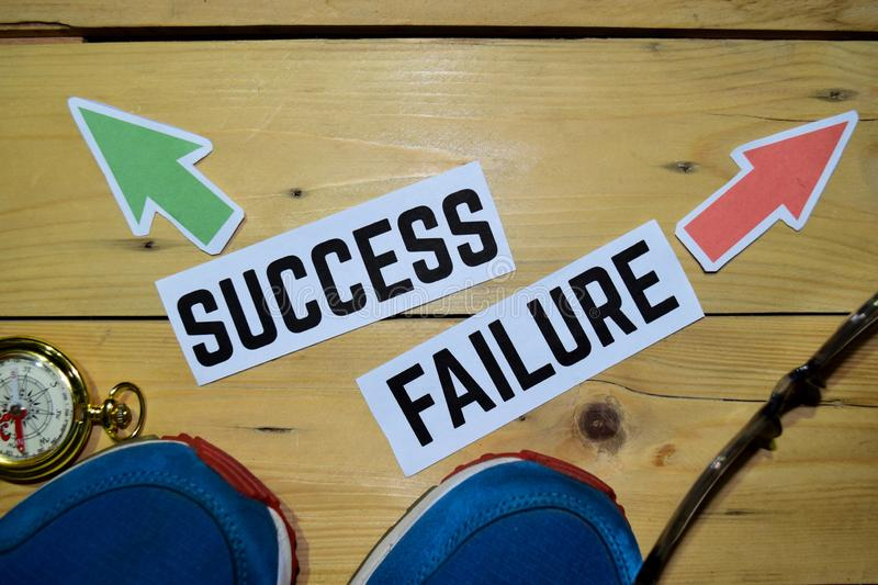 Success or Failure opposite direction signs with sneakers,eyeglasses and compass on wooden. Vintage background. Business, education and finance concepts royalty free stock images