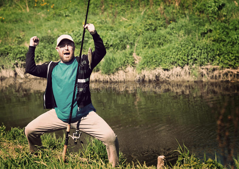 Success fishing, man with fishing rod. Funny, fun royalty free stock photo