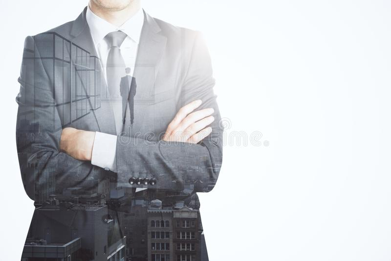 Success and future concept. Unrecognizable businessman standing on abstract whte city background with copy space. Success and future concept. Double exposure stock images
