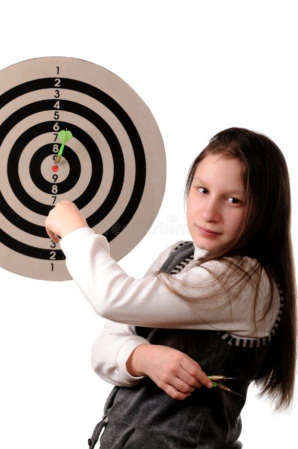 Success. Girl hitting the darts target