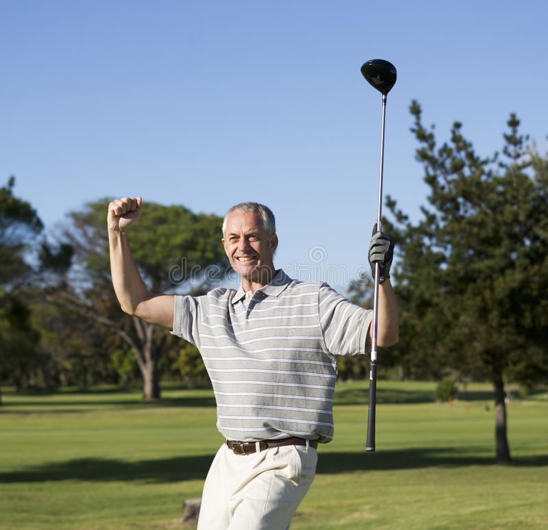 Success on the golf course stock photo