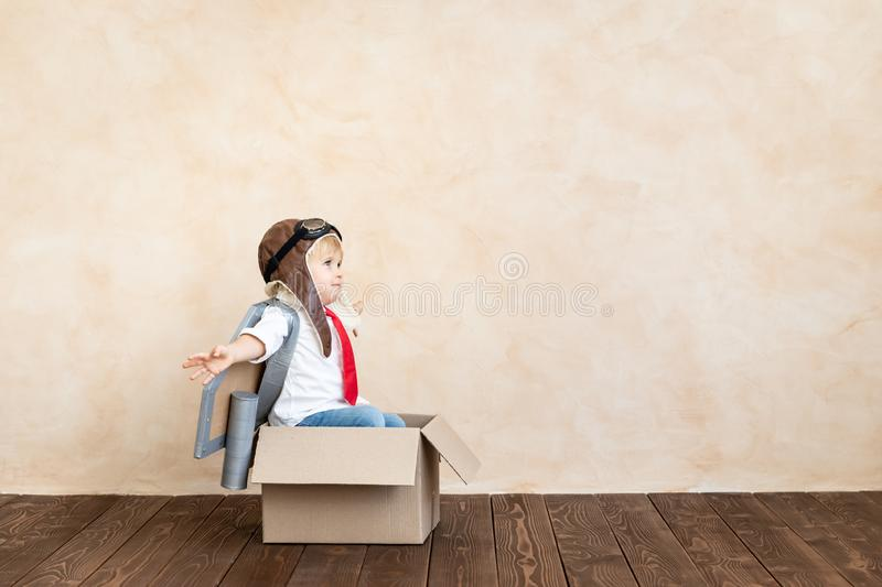 Success, imagination and innovation technology concept. Funny kid with toy jet pack. Happy child playing at home. Success, imagination and innovation technology royalty free stock photo