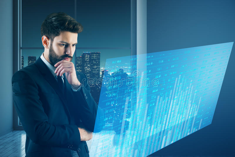 Success and innovation concept. Thoughtful businessman with digital business screen in abstract interior. Success and innovation concept. 3D Rendering stock images
