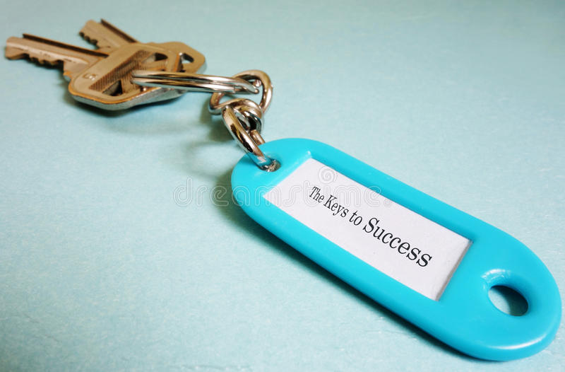 Success keys. Closeup of a keychain with Keys To Success text royalty free stock images