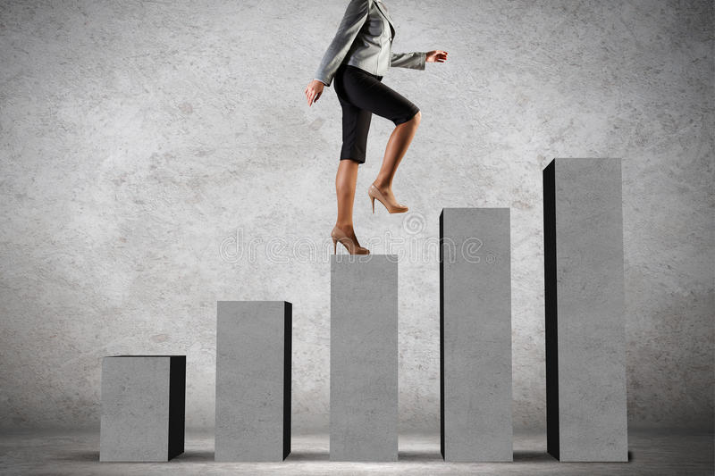 On success ladder. Young businesswoman stepping up on chart bar royalty free stock photos