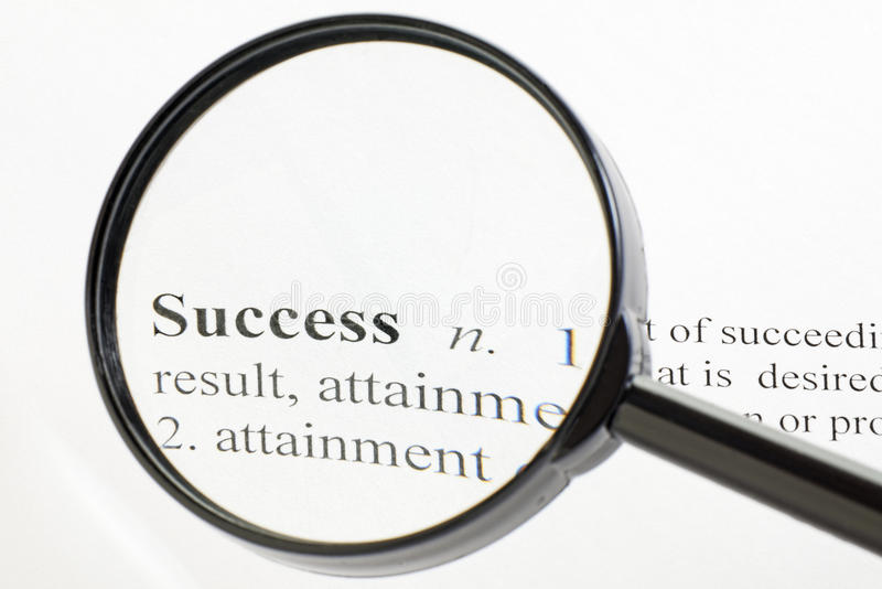 Success Magnified. The word success seen through a magnifying glass stock images