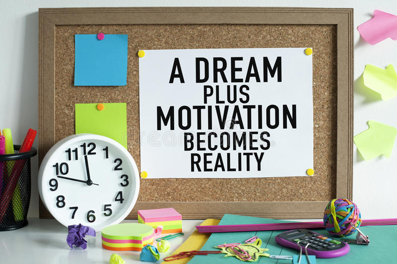 Success Motivation Concept. A dream plus motivation becomes reality quote on cork board in office, motivational success concept royalty free stock photos