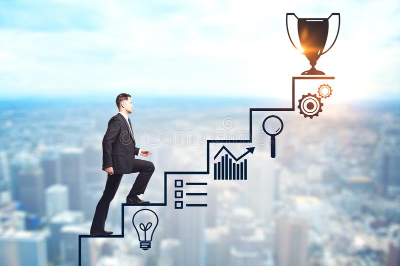 Success and promotion concept. Businessman climbing creative steps and award sketch on blurry city background. Success and promotion concept stock photos