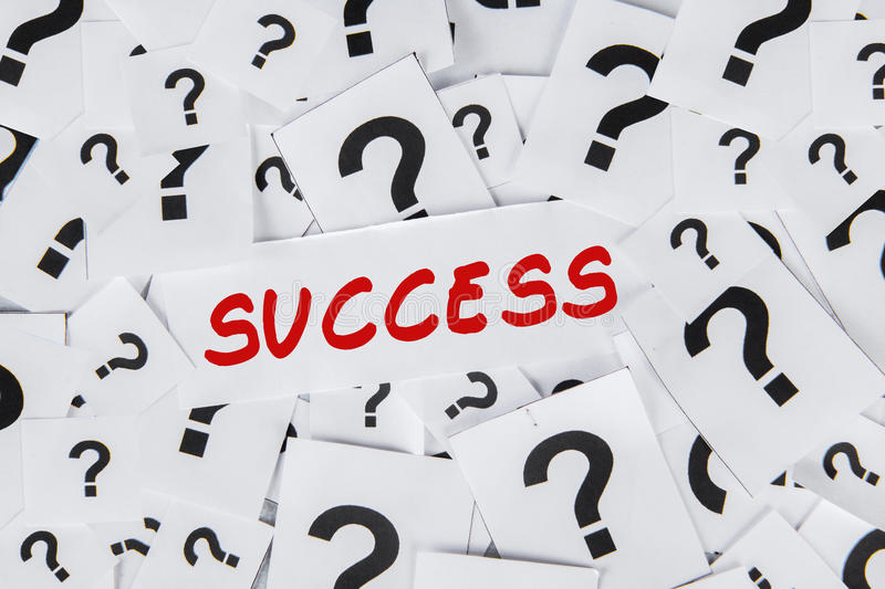 Success and question mark. Question about the success with too many question marks on papers stock photography