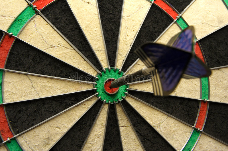 Success shot! Darts photo with arrow in bullseye stock photography
