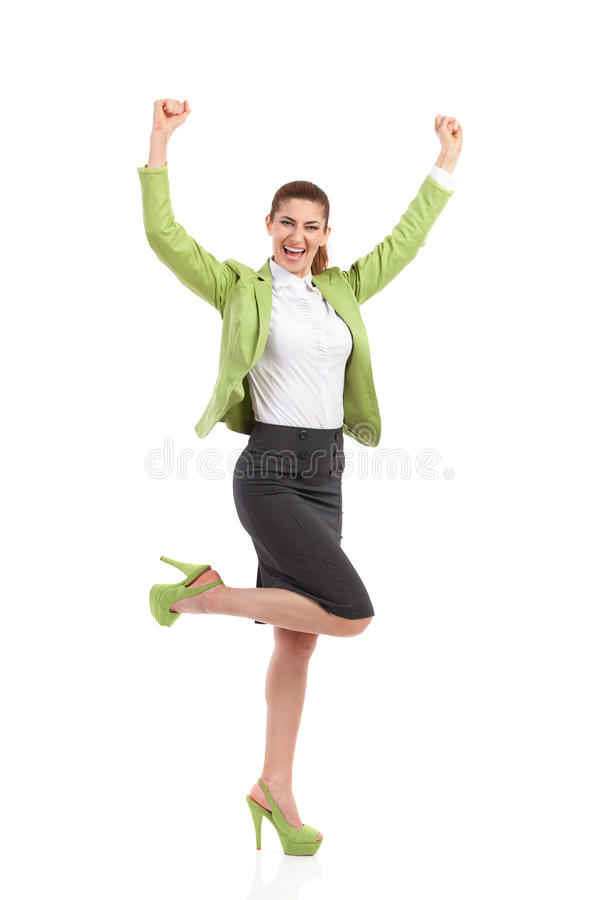 Success. Shouting businesswoman with raised hands. Full length studio shot isolated on white royalty free stock images