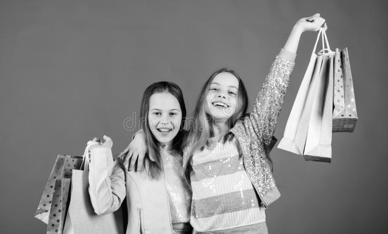 Success. Small girls with shopping bags. Sisterhood and family. savings on purchases. Kid fashion. Sales and discounts. Happy children. Little girl sisters stock photos
