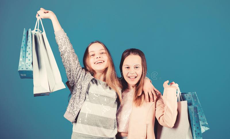 Success. Small girls with shopping bags. Sisterhood and family. savings on purchases. Kid fashion. Sales and discounts. Happy children. Little girl sisters royalty free stock image