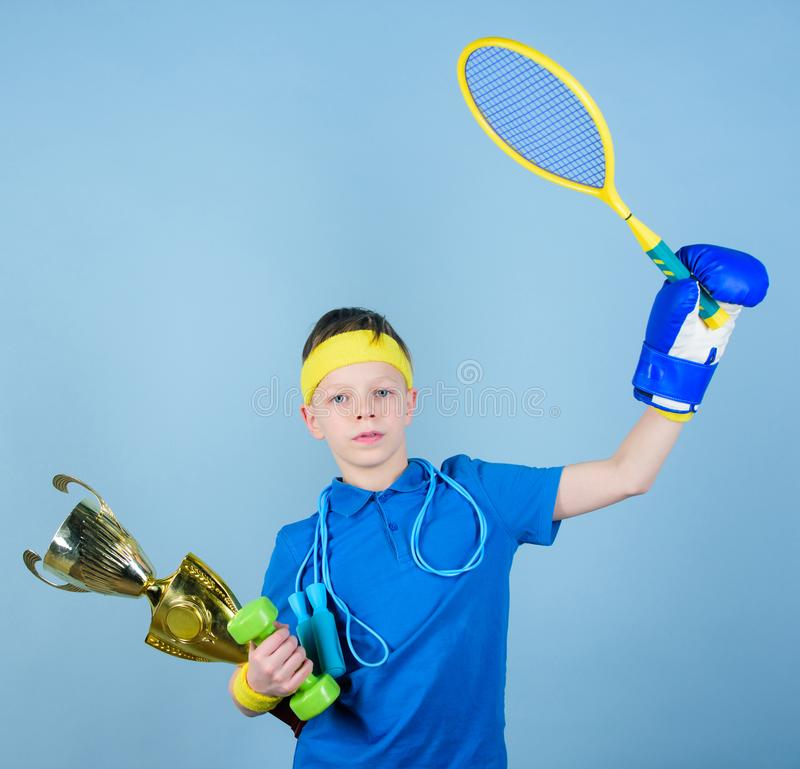 Success in sport. Succeed in everything. Athlete successful boy sport equipment jump rope boxing glove tennis racket stock photo