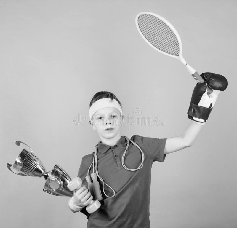 Success in sport. Succeed in everything. Athlete successful boy sport equipment jump rope boxing glove tennis racket royalty free stock photos