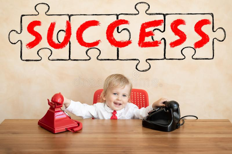 Success, start up and business idea concept. Happy child pretend to be businessmen. Funny kid playing at home. Education, start up and business idea concept stock photography
