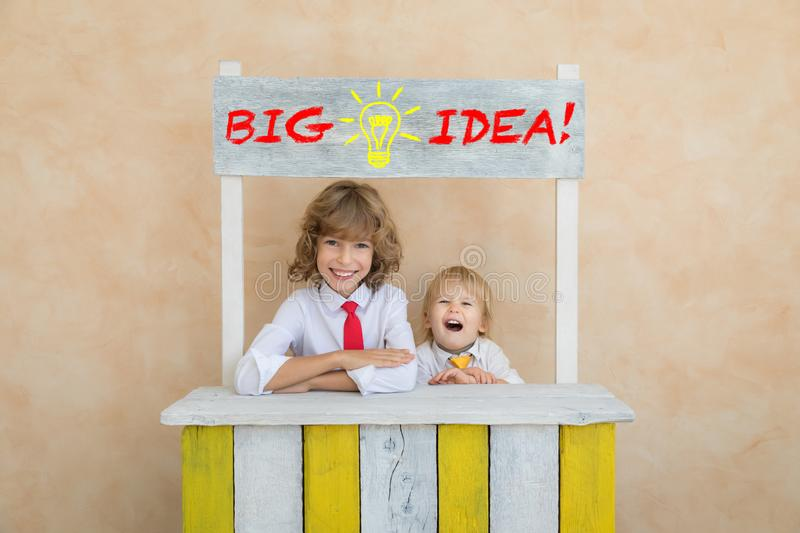 Success, start up and business idea concept. Happy children pretend to be businessmen. Funny kids playing at home. Education, start up and business idea concept royalty free stock image