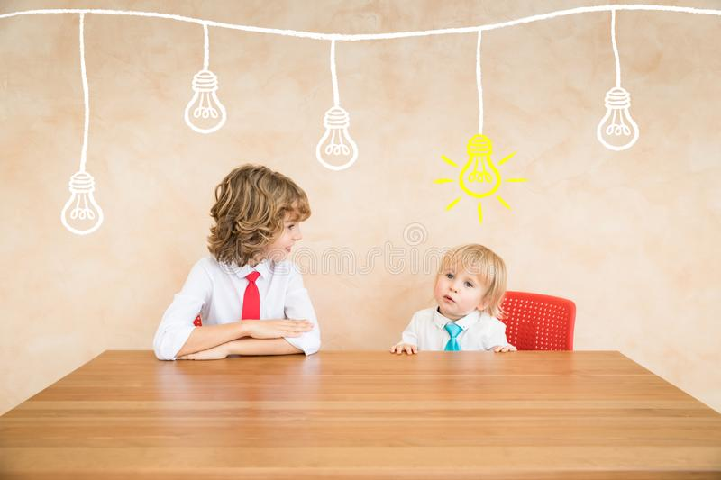 Success, start up and business idea concept. Happy children pretend to be businessmen. Funny kids playing at home. Education, start up and business idea concept royalty free stock photo