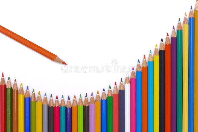 Success at stock market. Crayons show success at stock market stock photo
