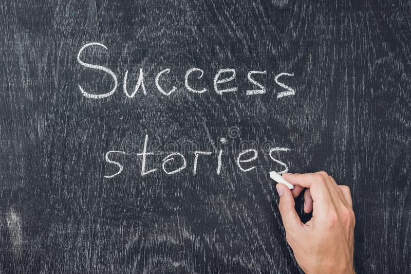 Success stories written on the blackboard using chalk stock images