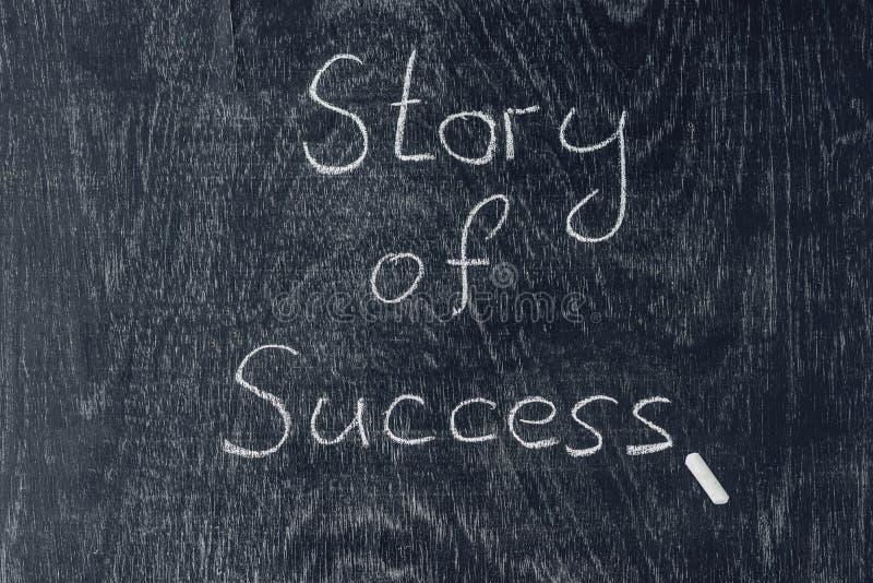 Success stories written on the blackboard using chalk royalty free stock photos