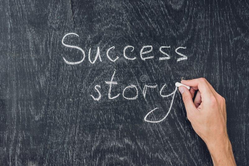 Success stories written on the blackboard using chalk royalty free stock photo