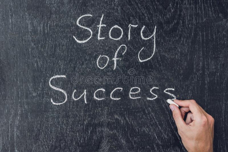 Success stories written on the blackboard using chalk royalty free stock image