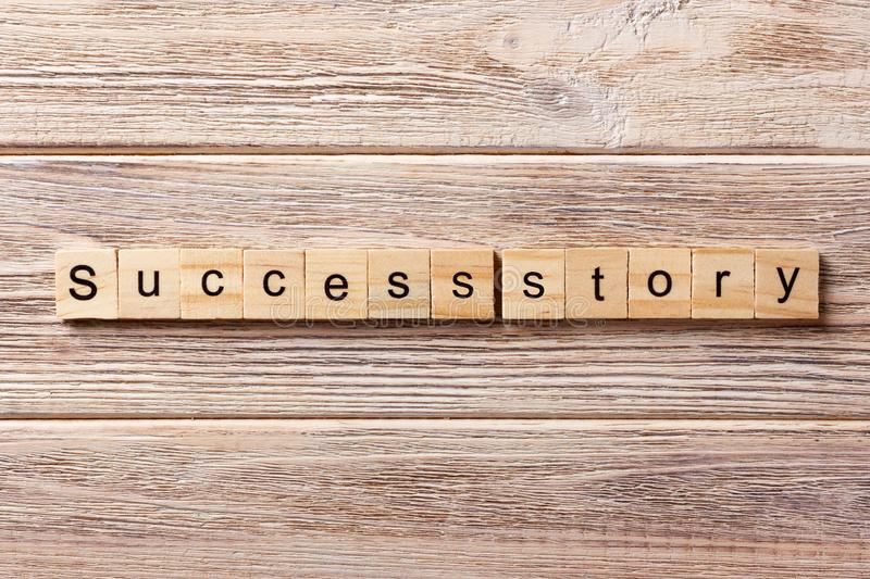 Success story word written on wood block. Success story text on table, concept stock photo