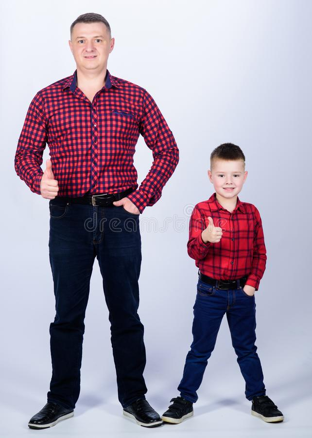 Success. thumb up gesture. happy family. fathers day. childhood. parenting. father and son in red checkered shirt. Little boy with dad man. Wild West is his stock photos