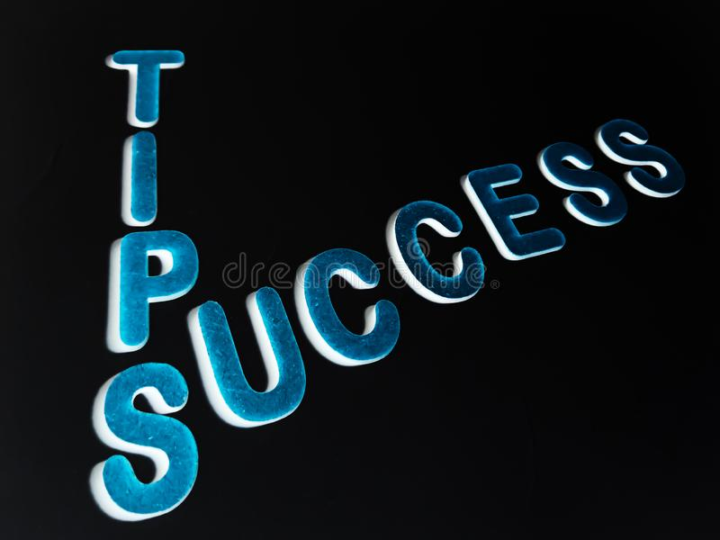 success tips text written on dark abstract background stock images