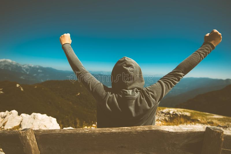 Success, triumph and victory. Victorious female person on mountain. Success, triumph and victory. Victorious female person standing on mountain top with arms stock photography
