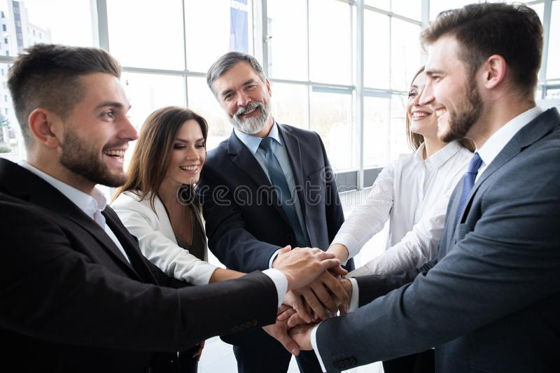 Success and winning concept - happy business team celebrating victory in office. royalty free stock image
