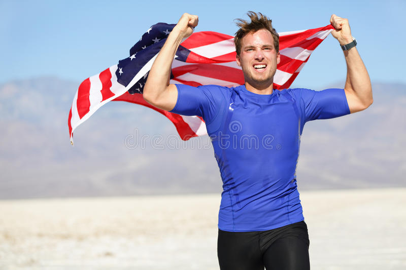 Success - winning runner cheering with USA flag stock photography