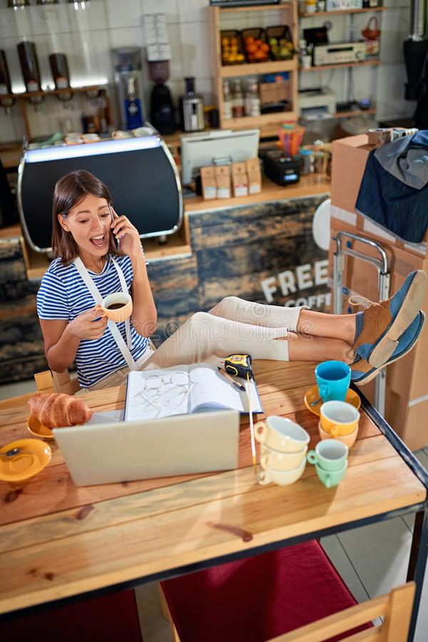 Success woman working with laptop ready to open their cafe royalty free stock image