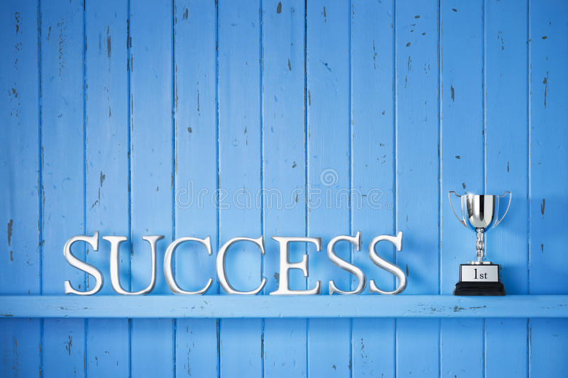 Success Trophy Winner Background. A blue painted wood background with the word success on it royalty free stock photography