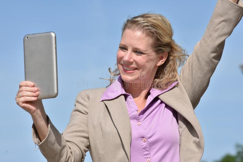 Successful Adult Blonde Business Woman Wearing Suit With Tablet stock photos