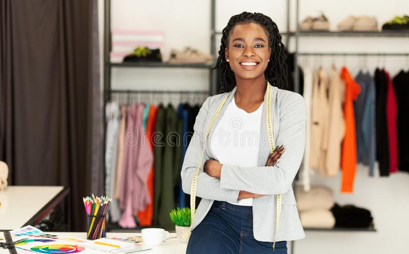 Successful African American Fashion Designer Smiling At Camera In Boutique stock image