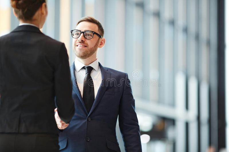 Businessman greeting colleague royalty free stock photo