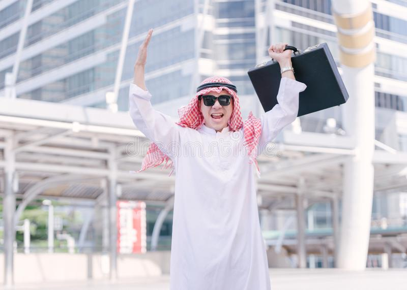 Successful Arabic businessman in the Middle east celebrating win stock images