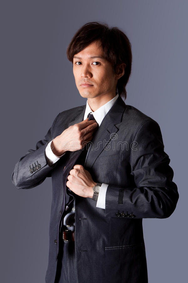 Download Successful Asian Business Man Fixing Tie Stock Image - Image: 12688135