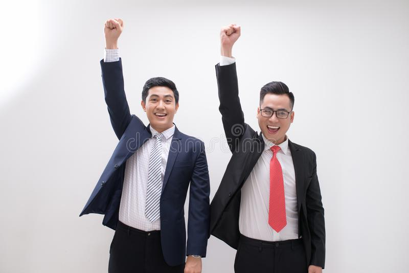Successful Asian business man hands up feeling happy or win with royalty free stock images