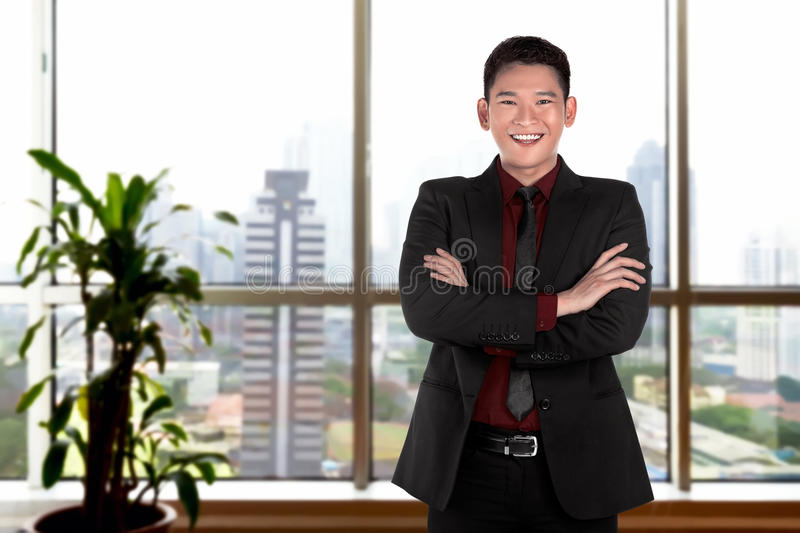 Successful asian business person. Image of successful asian business person in the office stock photography