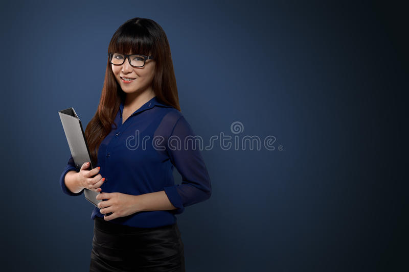 Successful asian business person. Image of successful asian business person over blue background royalty free stock photos