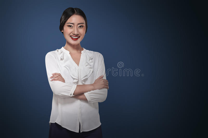 Successful asian business person. Image of successful asian business person over blue background royalty free stock photography