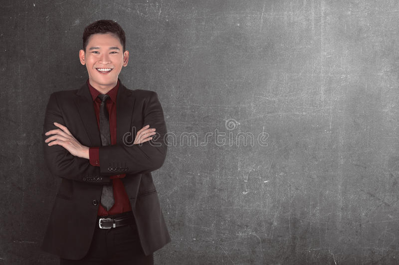 Successful asian business person. Image of successful asian business person over grey background stock image