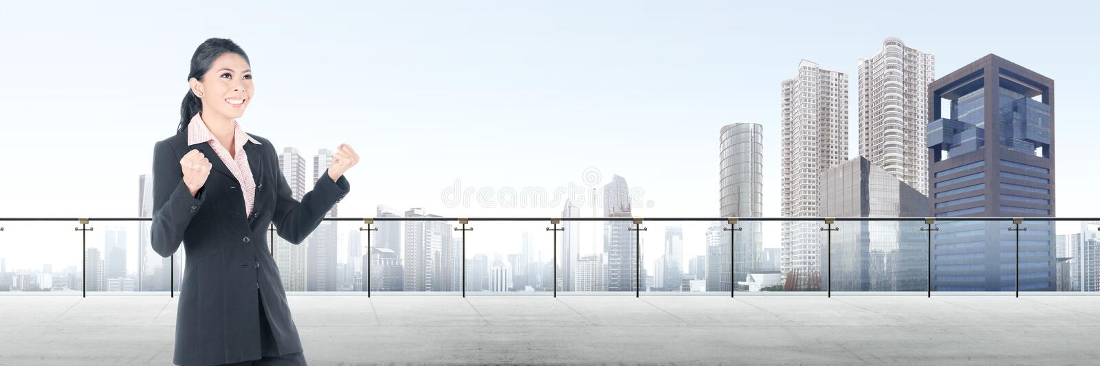 Successful asian business woman standing on modern terrace stock photography