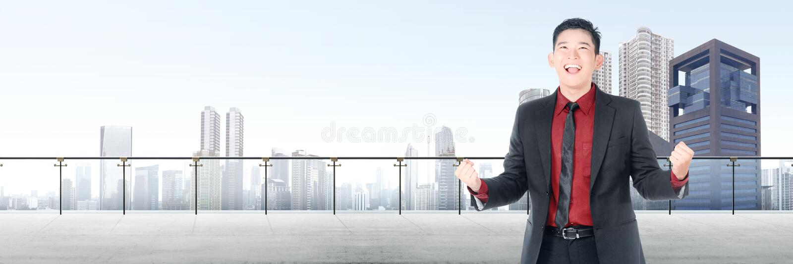 Successful asian businessman standing on modern terrace stock photography