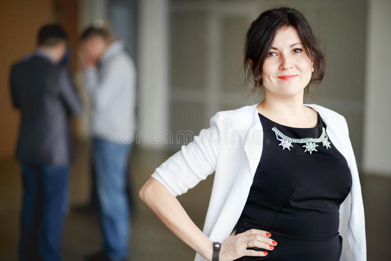 Successful attractive boss brunette with kind eyes royalty free stock photos