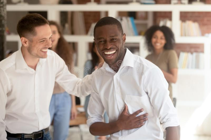 Successful black businessman looking at camera celebrating success got promotion. Successful proud black businessman looking at camera celebrating victory got stock photography